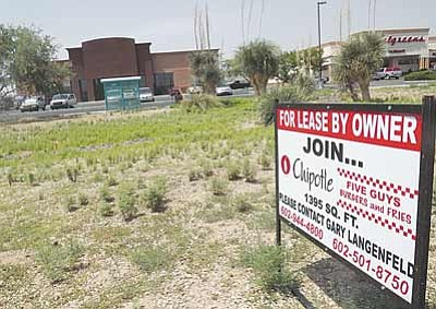 AHRON SHERMAN/Miner<br /><br /><!-- 1upcrlf2 -->A sign went up Tuesday in front of the vacant Blockbuster building inviting business owners to join Chipotle Mexican Grill and Five Guys Burgers and Fries by leasing one of the suites.