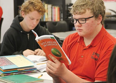 Blake Curran, 15, reads in Vickie MacLean's Cambridge First Language English class Friday morning. (JC AMBERLYN/Miner)
