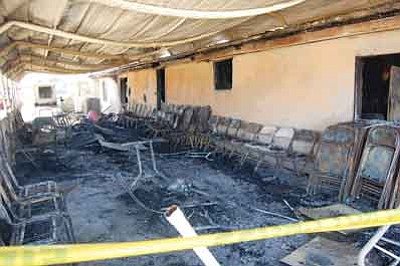 Arson is suspected in two church burnings that occurred Saturday night in Dolan Springs. Here, fire destroyed about 35 percent of the Dolan Springs Baptist Church, according to Pastor Chris Zeller.<br /><br /><!-- 1upcrlf2 -->