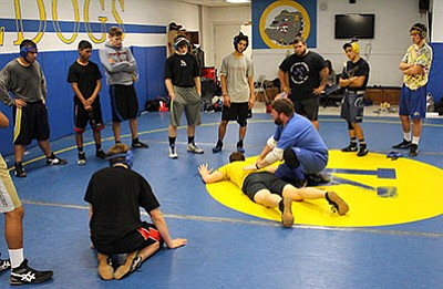 KHS wrestling coach Brandon Clor offers advice on technique during a recent practice. (SHAWN BYRNE/Miner)