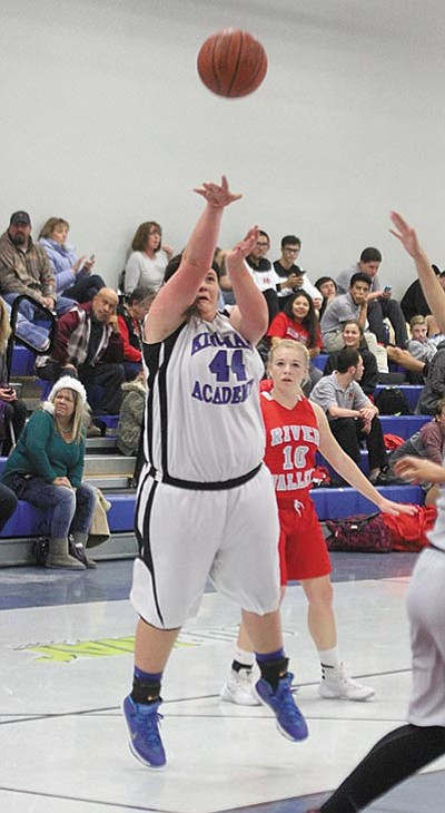 Kingman Academy's Amberlee Steed puts up a shot Dec. 18 against River Valley. Steed scored eight points in the Lady Tigers' first win of the season Tuesday over Joy Christian, 34-21. (JC AMBERLYN/Miner)
