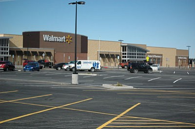 The new Walmart on Glassford Hill Road in Prescott Valley shows evidence of employees preparing inside for the store's opening, slated for Jan. 15. The corporation first proposed the store well before the recession hit in 2007.<br> Trib Photo/Briana Lonas