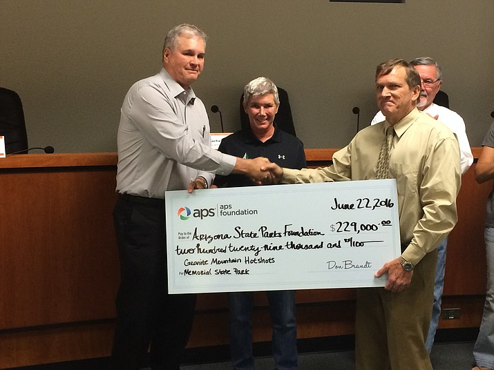 (R to L) Steve Quinn, APS' Prescott Division Manager presented a check for $229,000, the amount needed to finish the memorial park, to State Parks Executive Director Sue Black and Jim Buster, president of the Arizona State Parks Foundation on Wednesday, June 22.