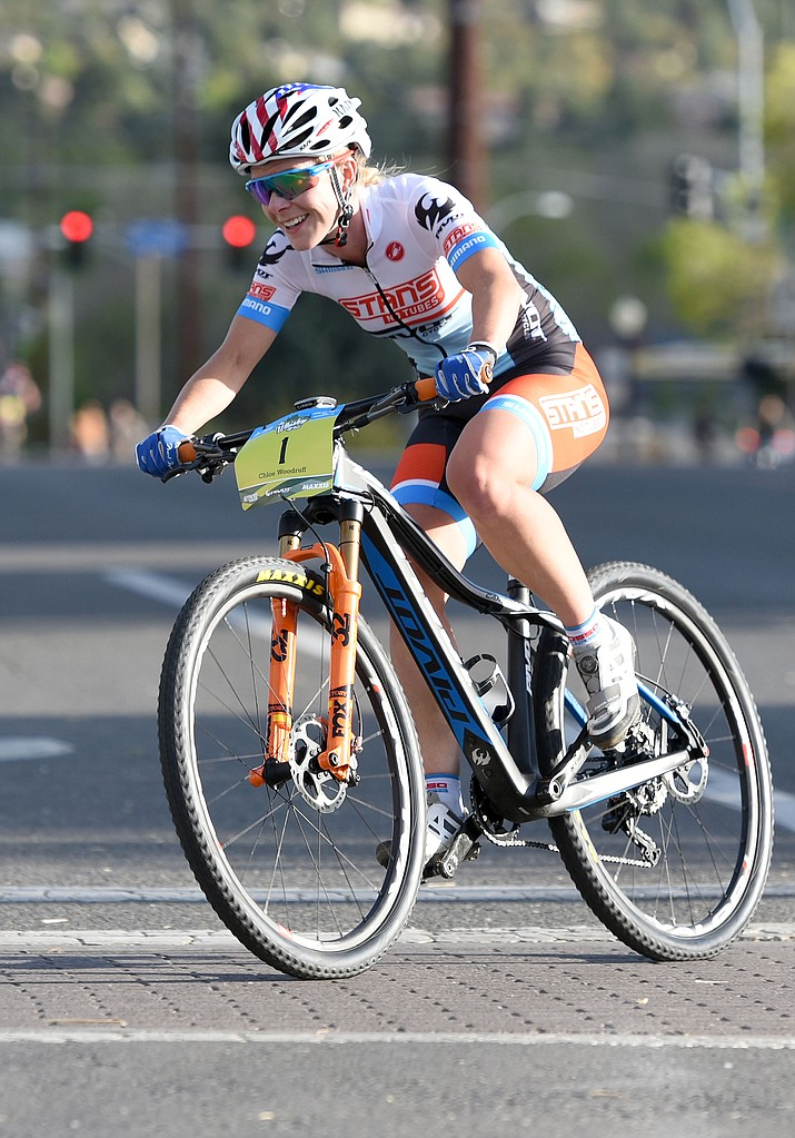 Chloe Woodruff rockets through a turn Friday evening April 29, 2016 during the 13th Annual Whiskey Off-Road Fat Tire Criterium in downtown Prescott.  Wodruff finished the race in third place.