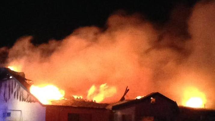 Firefighters battle blaze caused by lightning strike
