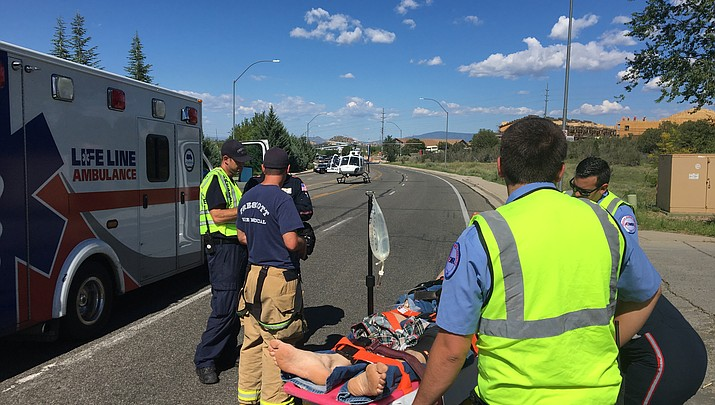 Motorcyclist injured in collision with car