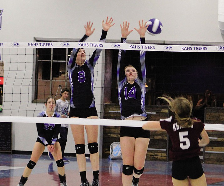Kingman Academy's Breezy Weber (8) and Aspen Jackson (14) go for a block during Thursday's loss to No. 6 Trivium Prep at KAHS.