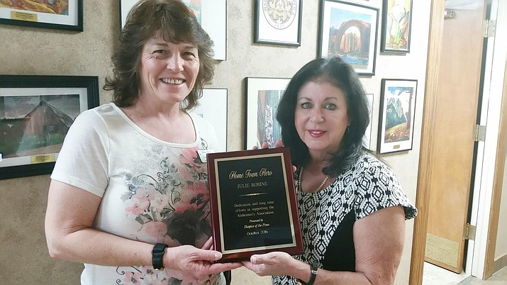 Julie Keeney (left), Hospice of the Pines, presents Julie Robins with this month's Hometown Hero of the Month award. (Courtesy photo)