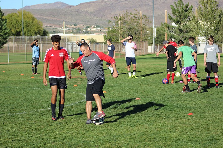 Lee Williams' new boys soccer coach Gabe Otero demonstrates a drill for both the Vols and Lady Vols during practice Friday morning at Centennial Park. Four teams at LWHS have new coaches this winter season.