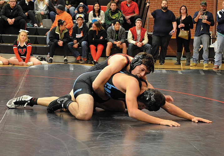 Lee Williams' Trevor Shaffer (top) works for an advantage against his Cactus opponent Wednesday in a 160-pound match. Shaffer went on to win and finished 3-0 with additional wins against Mohave and Lake Havasu.