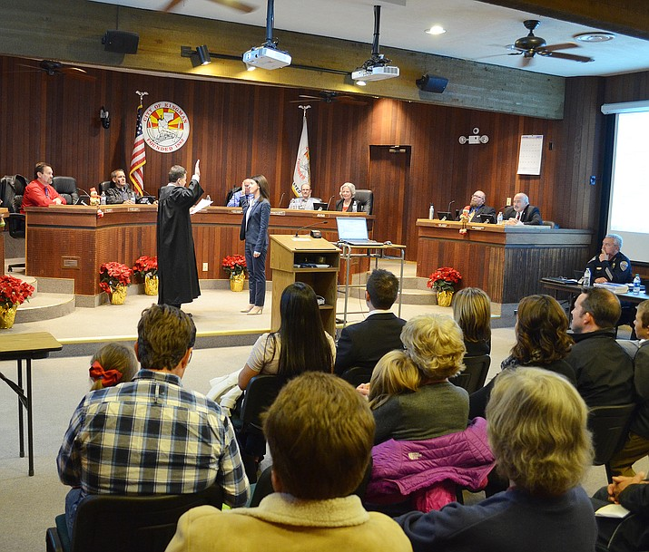 Kingman Municipal Court Judge Jeffrey Singer swears in new City Councilwoman Jamie Scott Stehly in front of a packed city hall chamber at Tuesday's City Council meeting.