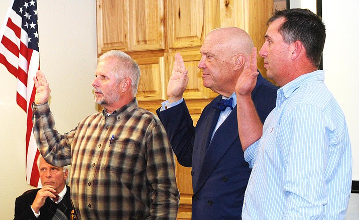 Valley Academy for Career and Technical Education swears in returning board member Steve Pike, and new board members Frank Vander Horst, and Jeff Wassell, from left, at the Nov. 30 meeting in Cottonwood. (Courtesy photo)