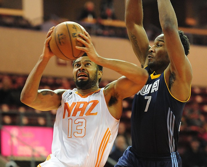 Northern Arizona's Xavier Silas goes hard to the hoop as the Suns take on the Iowa Energy Saturday, December 10 at the Prescott Valley Event Center.