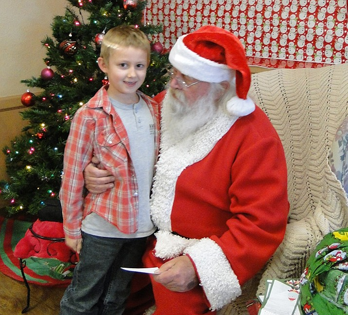 Santa listens at the Cookies with Santa event
