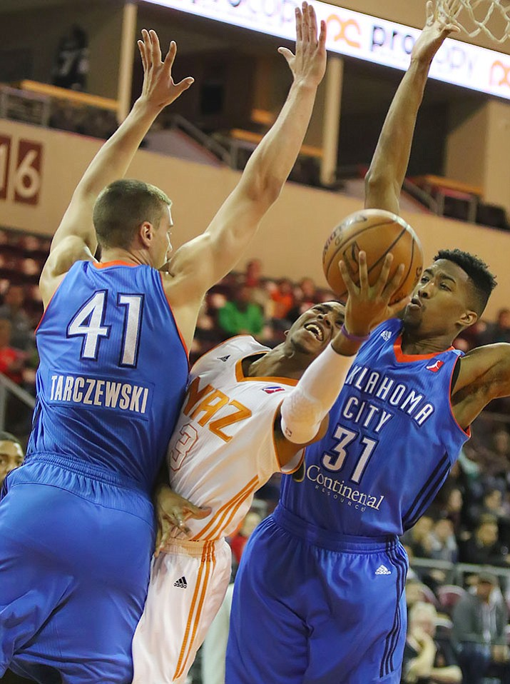 Northern Arizona Suns guard Shaquille Harrison (3) squeezes between two Oklahoma City defenders during their NBA Development League game Friday, Dec. 23, at the Prescott Valley Event Center.