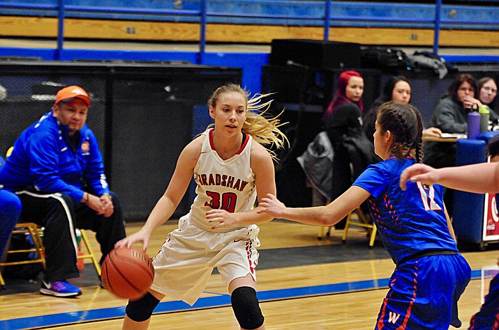 Bradshaw Mountain's Elah Alvis looks for an open post player Thursday, Dec. 29, at the Prescott Lady Badgers Winter Classic. (Brian M. Bergner Jr./The Daily Courier)