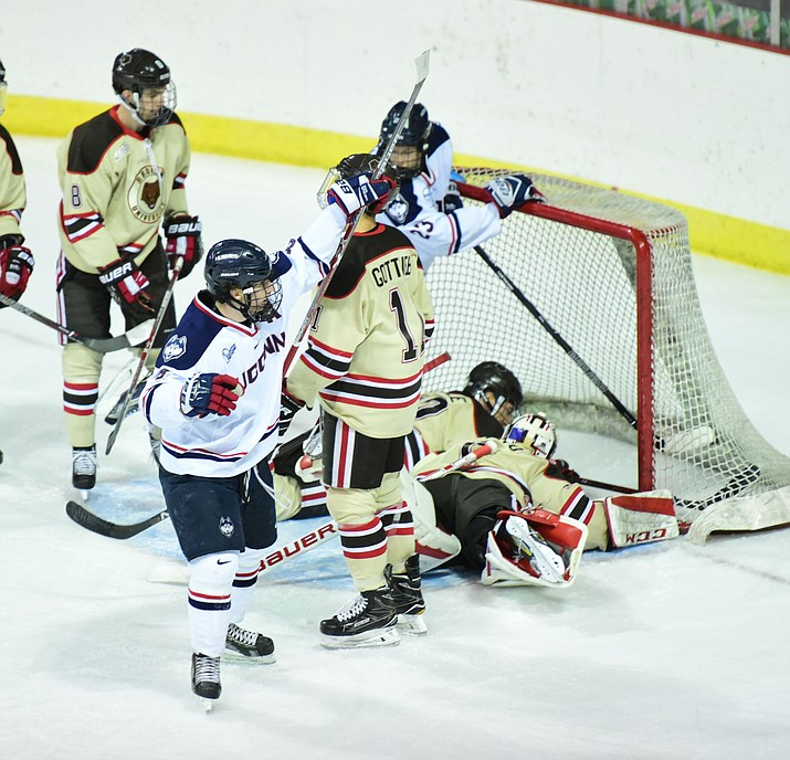 UConn players celebrate a second period goal as the Bears from Brown University take on the UConn Huskies in the championship match of the Desert Hockey Classic at the Prescott Valley Event Center Saturday, December 31. (Les Stukenberg/The Daily Courier)