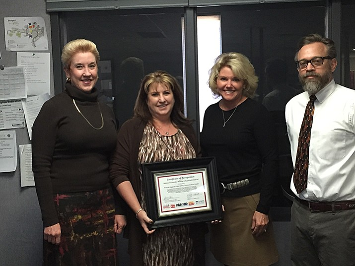 Prescott Police Chief Debora Black, second from right and Prescott City Manager Michael Lamar, right, present PRCC Manager Peggy Ford-Skibbe and PRCC Supervisor Vivian Marcott with the certificate.