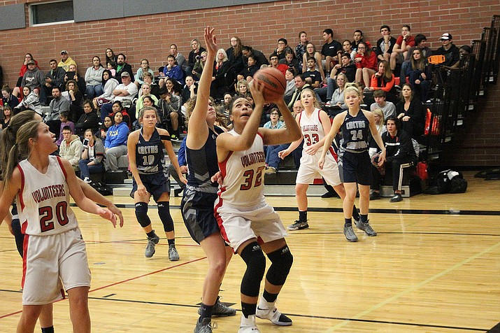 Chania Scott goes up for two points against Cactus Shadows Nov. 30. Lee Williams is at Mohave Friday.