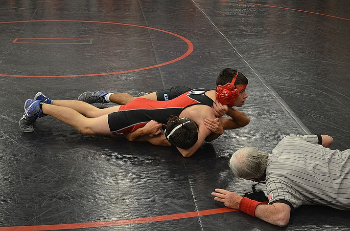 Lee Williams' Wyatt Parker has the upper hand against Cactus on Nov. 30. The Volunteers are 17-7 on the season and wrestle at the Joseph City Invitational this weekend.