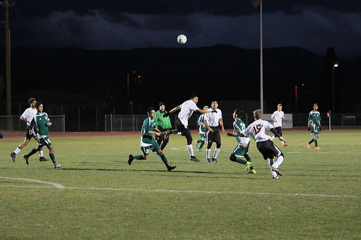 Lee Williams' captain, senior Carlos Castaneda (center), hits a header during action against Flagstaff Thursday night in a 4-1 home loss.