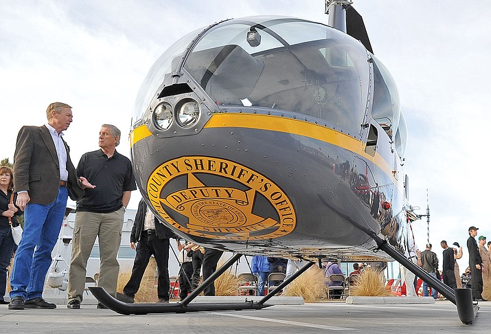 Former Yavapai County Sheriff Steve Waugh talks with Yavapai County Supervisor Tom Thurman about the YCSO's R44 helicopter in 2012. The helicopter is operated at no taxpayer cost through RICO funds.