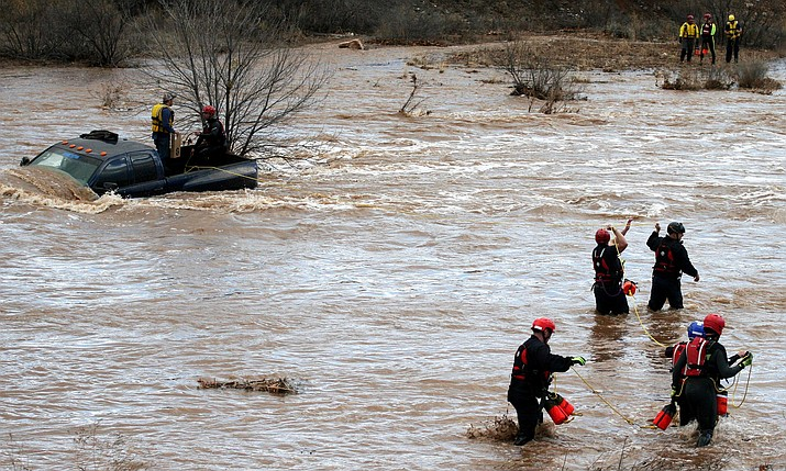 Emergency crews rescue a stranded motorist in Dry Beaver Creek at Kimberly Drive in McGuireville Dec. 22, 2016. (VVN/Bill Helm)