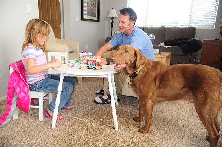 Matt Fay and his daughter, Olivia, enjoy playing with Lego's at their new home he and his wife purchased with a VA Loan in the Granville subdivision of Prescott Valley.