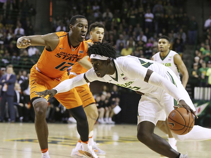 Baylor forward Johnathan Motley, right, drives on Oklahoma State forward Cameron McGriff, in their NCAA college basketball game, Saturday, Jan. 7. Baylor won 61-57. (Rod Aydelotte/The AP)