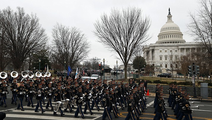 The Latest: Parade, military bands begin march to White House