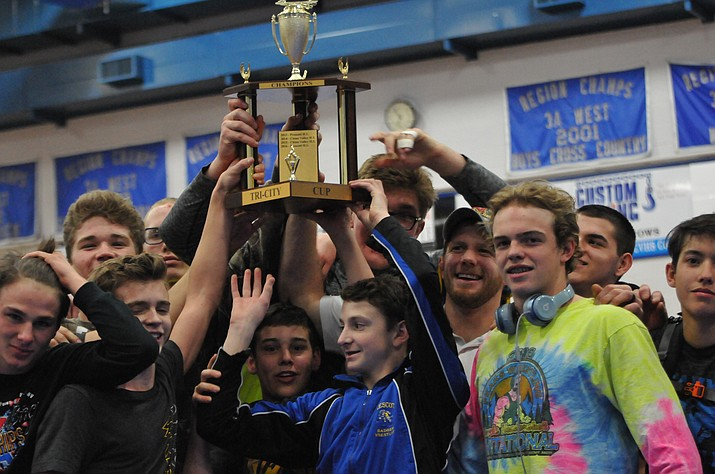 """The Prescott wrestling team captured the Larry Legler Quad-City Cup Championship trophy for the second straight season on Friday night in Chino Valley. The Badgers narrowly defeated the Cougars to hang onto the cup for another year. Prescott finished the meet 3-0, also beating rival Bradshaw Mountain and Mayer. The Quad-City Cup Championship trophy used to be the """"Tri-City Cup,"""" until Mayer joined the tournament. (Doug Cook/The Daily Courier)"""