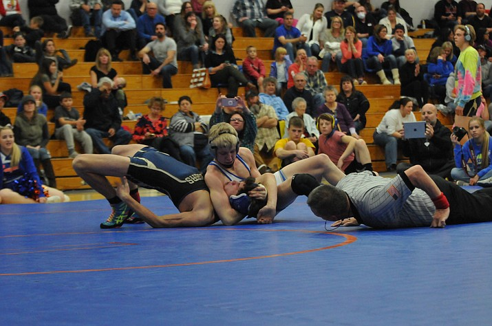 Chino freshman Keller Rock defeats Prescott High's Koby Coates in a 138-pound match.