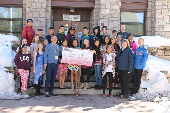 Kristin Manning's sixth grade science class raised more than $300 for the Second Chance Center for Animals in Flagstaff.