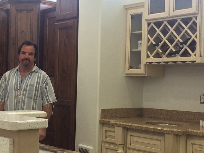 Robert Myers, owner of Northern Arizona Woodworking, in the company's showroom.