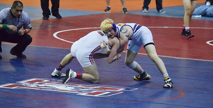 Camp Verde's Hayden Uhler (41-0) won his first three matches by pin and then won his fourth state title with a 5-2 victory in the 138-pound championship. (VVN/James Kelley)