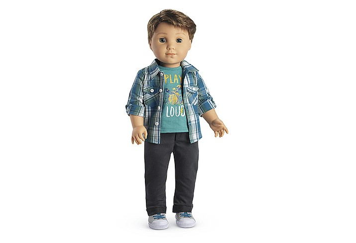 """The 18-inch """"Logan Everett"""" doll will go on sale this week. American Girl, which is owned by Barbie maker Mattel Inc., says Logan is a drummer and will come with a doll-sized drum kit."""