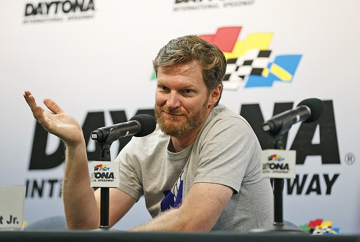 Dale Earnhardt Jr. gestures as he speaks during a news conference before the start of a NASCAR Sprint Cup practice Thursday, Feb. 16, at Daytona International Speedway in Daytona Beach, Fla. (Wilfredo Lee/Associated Press)