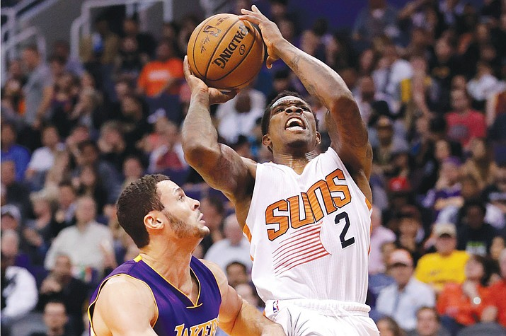 Phoenix Suns guard Eric Bledsoe (2) shoots over Los Angeles Lakers forward Larry Nance Jr. during the second half of an NBA basketball game, Wednesday, Feb. 15, in Phoenix.