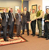 A dozen federal officials sworn in to aid local officials photo