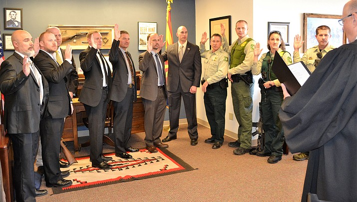 A dozen federal officials sworn in to aid local officials