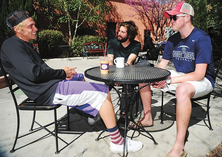 From left, Jacob Eriksson, Adam Haar and Jack Miles share a laugh at Wild Iris Coffee House on Friday, April 15. Haar is a Student Life Coordinator and former participant at TreeHouse Learning Community, which offers a sober living environment specifically for college students. Eriksson and Miles are students currently going through TreeHouse's program.