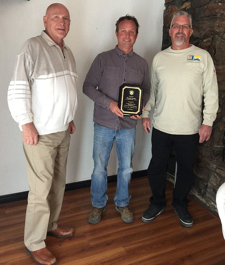 Dustin Lewis was recognized at the planning and zoning annual report luncheon Feb. 26. From left are Economic Development Director Greg Kellogg, Lewis, and Chairman Gary Fredrickson. (Photo courtesy City Planning and Zoning Commision)