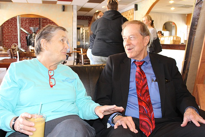 Marty Luna-Wolfe, left, chairwoman of the Mohave County Democratic Central Committee, has a friendly and respectful discussion with Mohave Republican Forum President Richard Basinger over political topics and views Friday at Beale Street Brews coffeehouse. (Hubble Ray Smith/Daily Miner)
