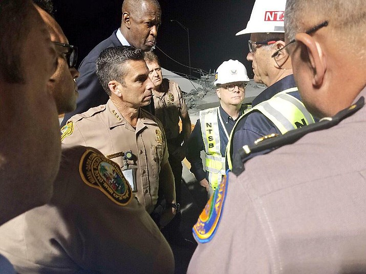 Director Perez meeting with National Transportation Safety Board Chairman Robert Sumwalt about the FIU Bridge Collapse investigation, while surveying the scene. (Photo by Miami-Dade Police Department)