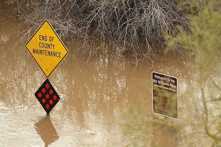 Areas of Planet Ranch Road are closed Thursday due to flooding caused by a planned release of water from Alamo Dam into the Bill Williams River. (Photo by Brandon Messick/For the Daily Miner)