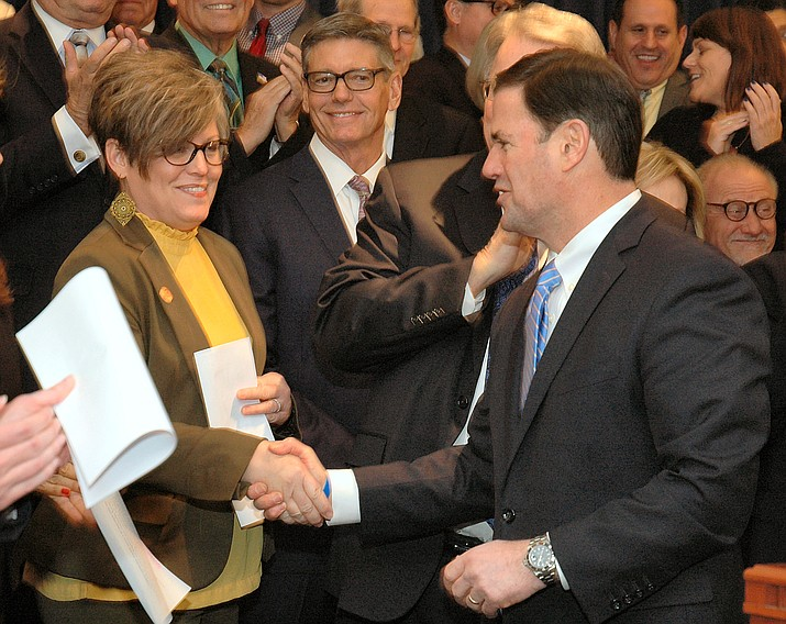 "Democratic Sen. Katie Hobbs, shown greeting Gov. Doug Ducey, says this extension will not fix the ""fiscal cliff"" and will simply maintain the status quo. (File Photo)"