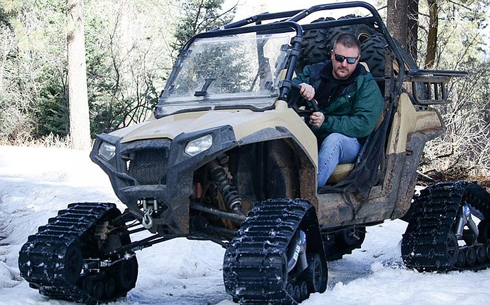 USDA's Travis Kolling backs up the UTV he drives to get to the snowpack measuring site. (Photo by Casey Kuhn/KJZZ)