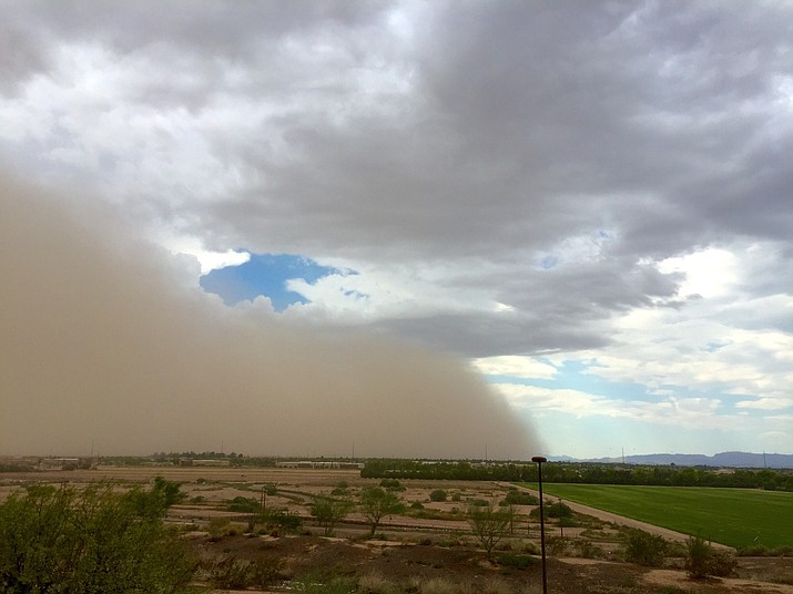 A large dust storm, or haboob, sweeps across some farmland. Drought is tightening its grip across a wide swath of the American Southwest as farmers, ranchers and water managers throughout the region brace for what's expected to be more warm and dry weather through the spring. (Adobe Images)