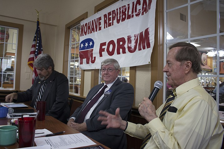 Richard Basinger, president of Mohave Republican Forum, poses a question for Arizona Corporation Commission candidates Jim O'Connor, center, and Neil DeSanto at the Forum's monthly meeting Wednesday. (Photo by Hubble Ray Smith/Daily Miner)