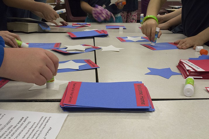 Students at Cerbat Elementary working on the Vietnam Veteran's Day cards to hand out during their ceremony. (Photo by Vanessa Espinoza/Daily Miner)